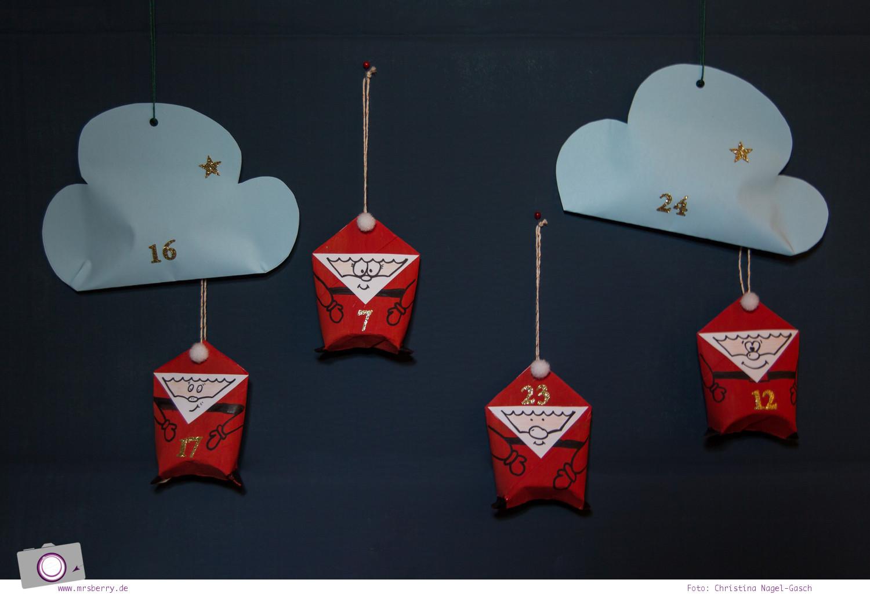 Adventskalender selber machen: basteln mit Klorollen - Wolken aus Papier basteln