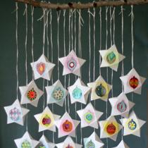 Adventskalender selber machen - die schönsten Ideen: gefüllte Sternschachteln